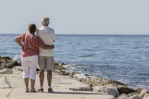 Retirees looking out at the ocean